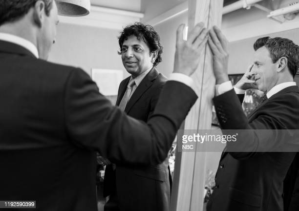 MEYERS — Episode 933 Pictured Filmmaker M Night Shyamalan talks with host Seth Meyers backstage on January 8 2020
