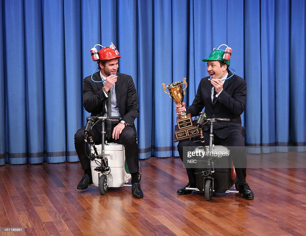 Liam Hemsworth and Jimmy Fallon race on cooler scooters on Thursday, November 21, 2013 --