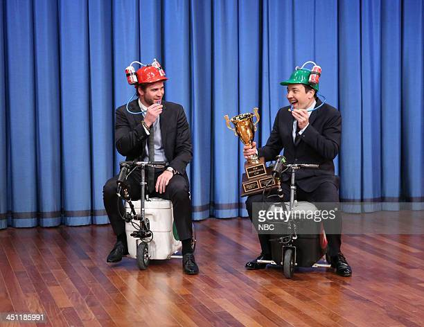 Liam Hemsworth and Jimmy Fallon race on cooler scooters on Thursday November 21 2013