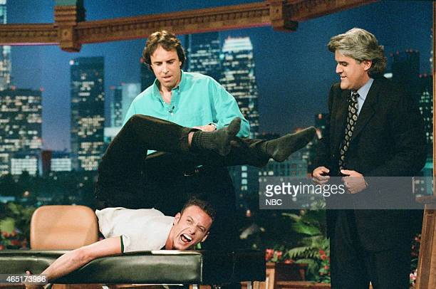 """Episode 936 -- Pictured: Actor Kevin Nealon and host Jay Leno during """"Kevin's Massage Contortionist"""" sketch on June 4, 1996 --"""