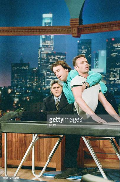 """Episode 936 -- Pictured: Host Jay Leno and actor Kevin Nealon during """"Kevin's Massage Contortionist"""" sketch on June 4, 1996 --"""