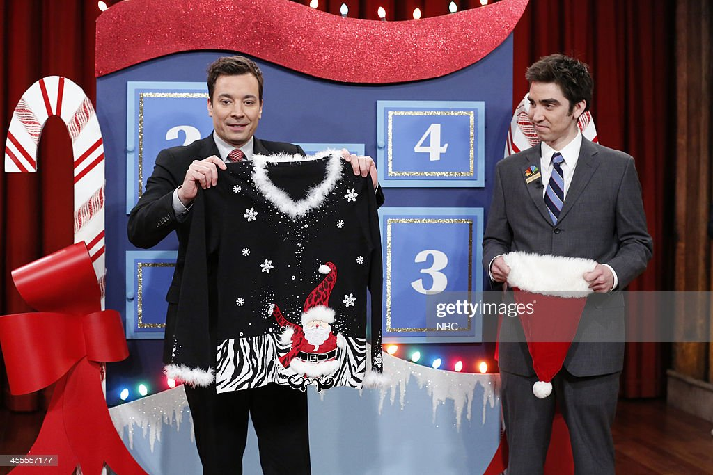 Host Jimmy Fallon gives away another festive Christmas sweater to one lucky audience member on day 3 of Five Days of Christmas Sweaters on Wednesday, December 11, 2013 -- (Photo by: Lloyd Bishop/NBC/NBCU Photo Bank via Getty Images).