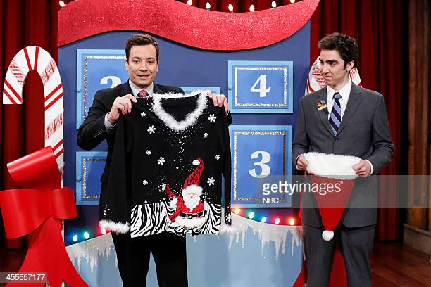 Host Jimmy Fallon gives away another festive Christmas sweater to one lucky audience member on day 3 of Five Days of Christmas Sweaters on Wednesday...