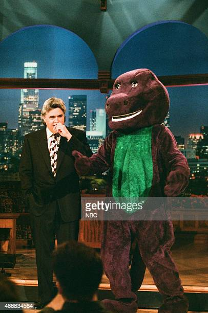 Host Jay Leno and Barney during the monologue on June 26 1996
