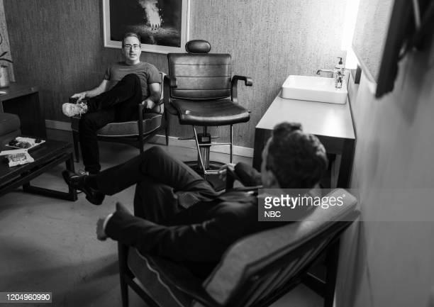 MEYERS Episode 959 Pictured John Oliver talks with host Seth Meyers backstage on March 3 2020