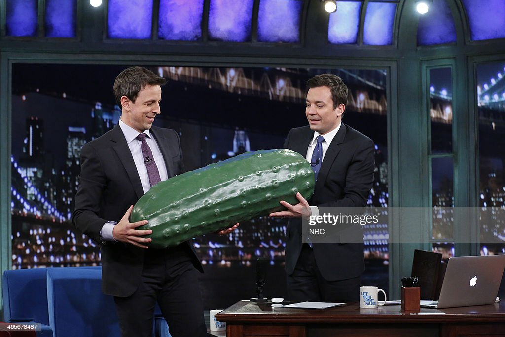 Jimmy passes the Late Night pickle down to Seth Meyers, the future Late Night host, on Tuesday, January 28, 2014 -- (Photo by: Lloyd Bishop/NBC/NBCU Photo Bank via Getty Images).