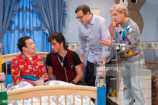 Host Jay Leno with former Full House cast members John Stamos Bob Saget and Dave Coulier make an appearance on Late Night with Jimmy Fallon on...