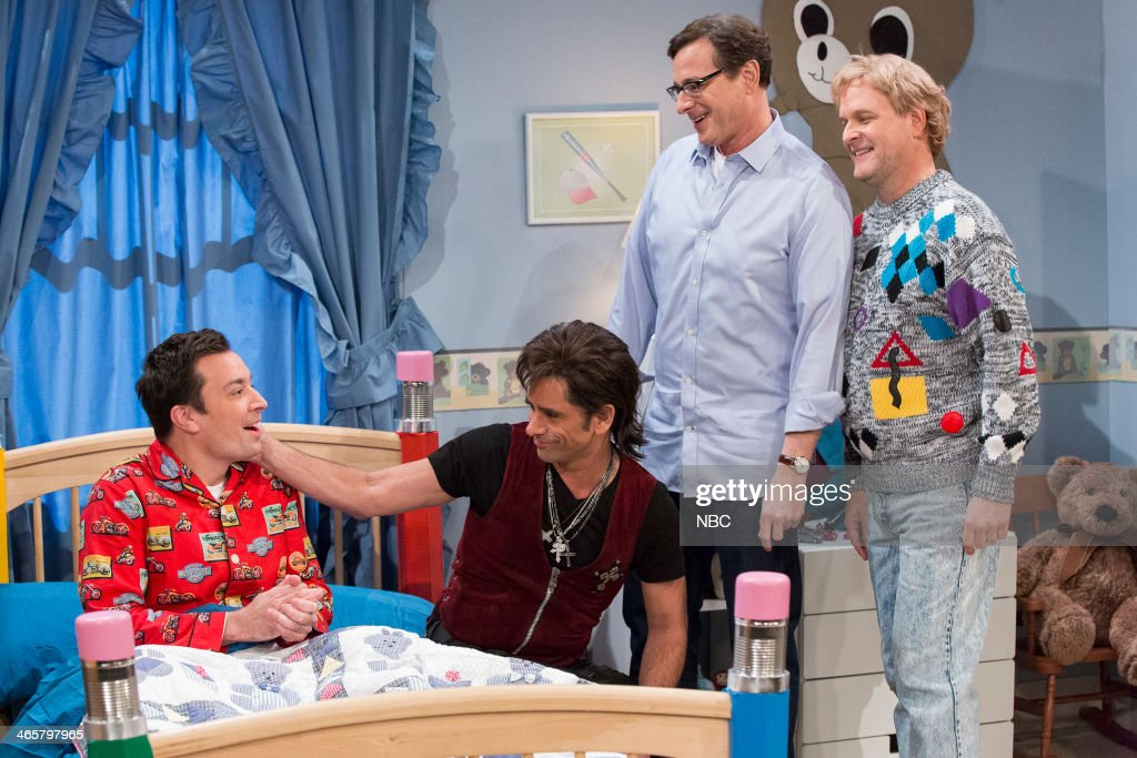 Host Jay Leno with former ?Full House? cast members John Stamos, Bob Saget and Dave Coulier make an appearance on ?Late Night with Jimmy Fallon? on Wednesday January 29, 2014 -- (Photo by: Lloyd Bishop/NBC/NBCU Photo Bank via Getty Images)..