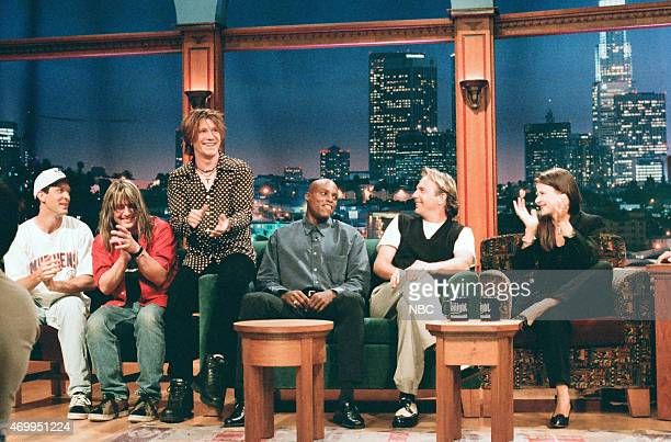 Musicians Mike Malinin Robby Takac and John Rzeznik of Goo Goo Dolls Olympic athlete Carl Lewis actor Kevin Costner and actress Tracey Ullman during...