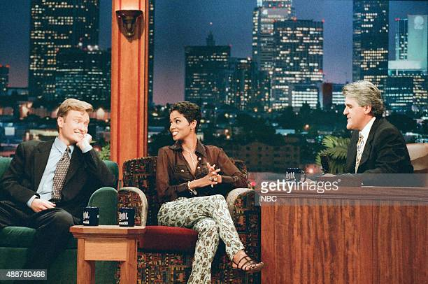 Episode 989 -- Pictured: Comedian Conan O'Brien and actress Halle Berry during an interview with host Jay Leno on September 9, 1996 --