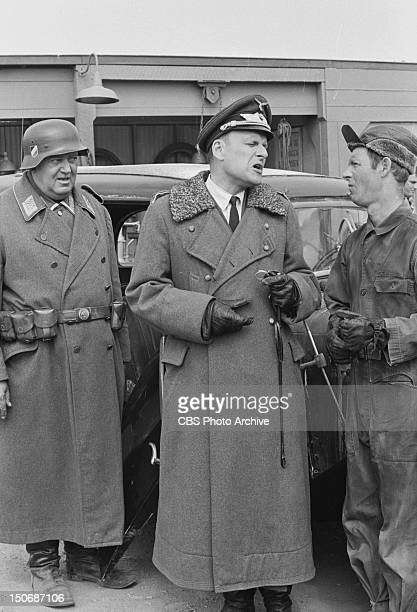 'Hogan's Trucking Service We Bring The Factory To You' From left John Banner as Sgt Hans Georg Schultz Werner Klemperer as Col Wilhelm Klink and...