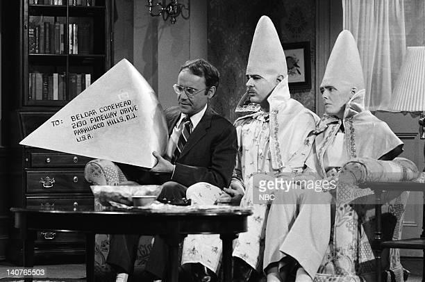 Buck Henry as Dr Ray Bondish Dan Aykroyd as Beldar Conehead Jane Curtin as Prymaat Conehead during Return of the Coneheads skit on May 21 1977 Photo...
