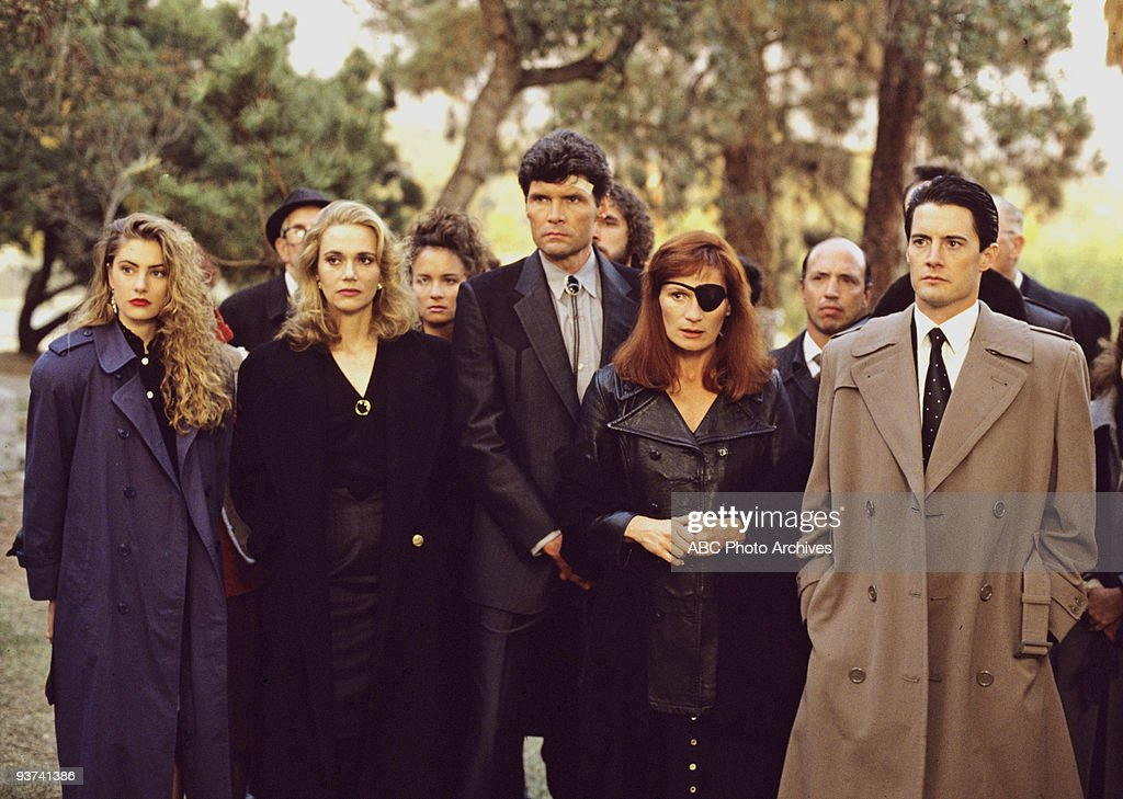 PEAKS - Episode Three - Season One - 4/26/1990, FBI Special Agent Dale Cooper (Kyle MacLaughlin, right) at former homecoming queen Laura Palmer's funeral with a lineup of mourners/suspects, from left: Shelly Johnson (Madchen Amick), Norma Jennings (Peggy Lipton), Ed Hurley (Everett McGill) and Nadine Hurley (Wendy Robie).,
