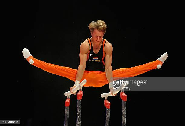 Epke Zonderland of Netherlands competes in the Parallel Bars during Day 4 of the 2015 World Artistic Gymnastics Championships at The SSE Hydro on...