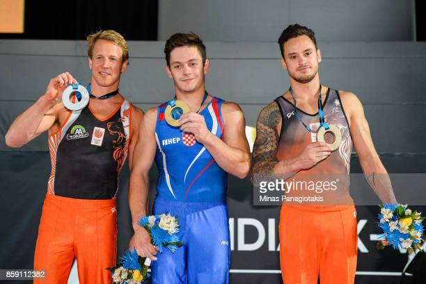 Epke Zonderland of Netherlands Tin Srbic of Croatia and Bart Deurloo of Netherlands pose for photos with their medals after competing on the...