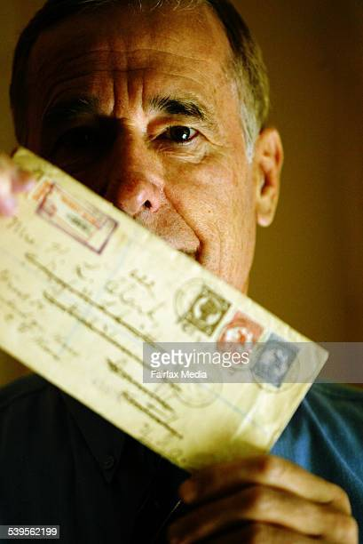 Epping resident Kevin Nelson with some of the stamped envelopes he collects 3 May 2005 SHD Picture by ANTHONY JOHNSON