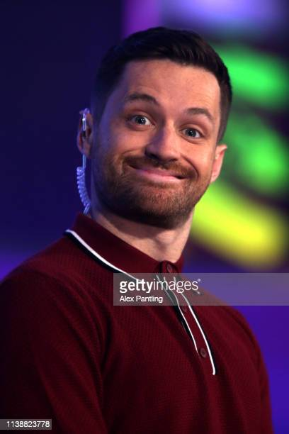 ePremier League presenter Spencer Owen reacts during day one of the 2019 ePremier League Finals at Gfinity Arena on March 28 2019 in London England
