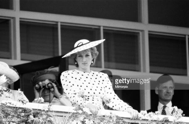 Epsom Derby 4th June 1986. Princess Diana at Balcony of Royal Enclosure. The Queen with binoculars in background.