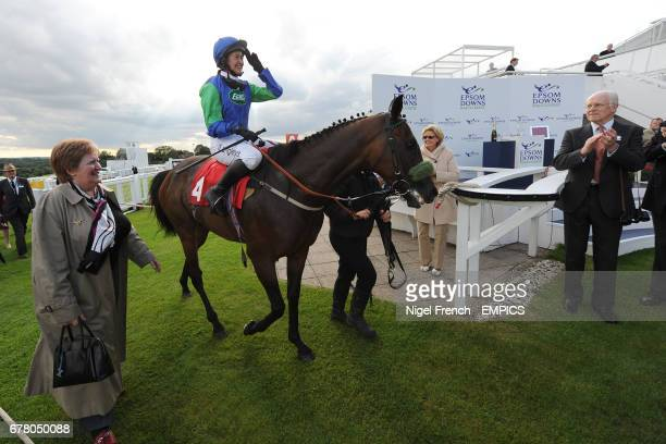 Epsom Salts ridden by jockey Serena Brotherton is lead into the winner's enclosure after winning the May Family Ladies' Derby Handicap