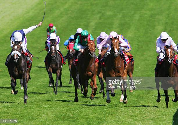 Epsom, UNITED KINGDOM: Sir Percy ridden by Martin Dwyer wins the Vodafone Derby at Epsom, Britain's Premier horse racing event, 03 June 2006. Second...