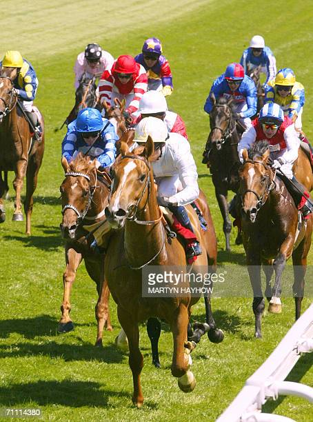 Epsom, UNITED KINGDOM: Stage Gift from Ireland ridden by Robert Winston wins the Vodafone Live! Stakes, the first race of the afternoon on the Derby...