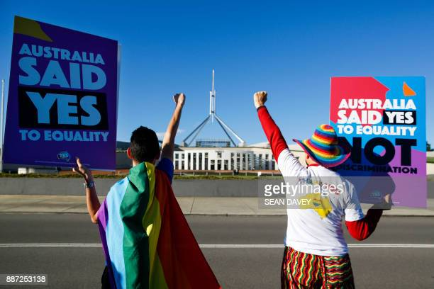 Equality ambassadors and volunteers from the Equality Campaign celebrate as they gather in front of Parliament House in Canberra on December 7 ahead...