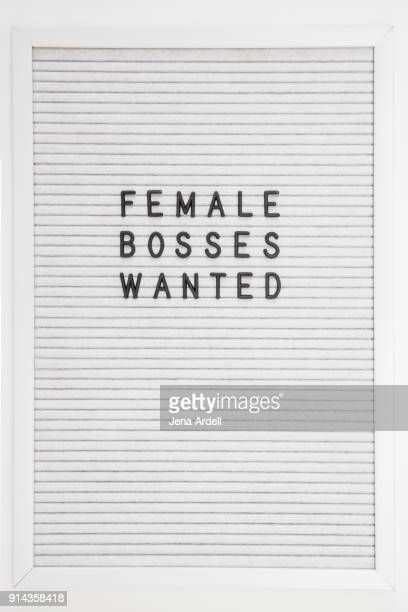 equality in workplace females bosses wanted letterboard - typographies stock photos and pictures