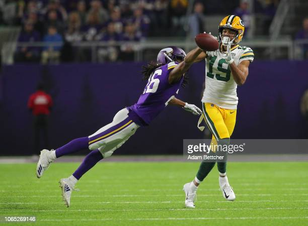 Equanimeous St. Brown of the Green Bay Packers pulls in a pass while Trae Waynes of the Minnesota Vikings applies pressure in the third quarter at...