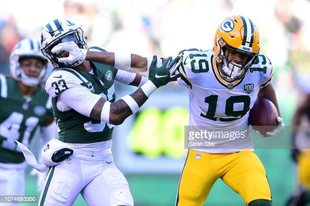 Equanimeous St Brown of the Green Bay Packers stiff arms Jamal Adams of the New York Jets during the second quarter at MetLife Stadium on December 23...