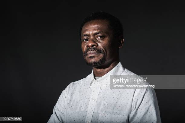 Equatoguinean writer Juan Tomas Avila Laurel attends a photocall during the annual Edinburgh International Book Festival at Charlotte Square Gardens...