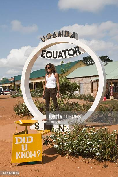Equator in Uganda with young woman