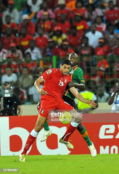 Equatorial Guinea midfielder JuanMaximo Eyama Ndong defends against Zambia's midfielder Isaac Chansa during their Group A match of the Africa Cup of...