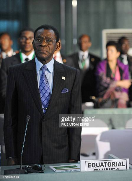 Equatorial Guinea President Obiang Nguema Mbasogo stands on July 15 2013 during the African Union anthem at the African Union Summit on health...
