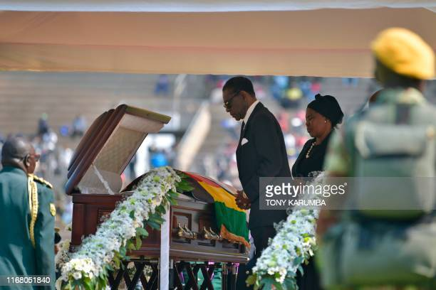 Equatorial Guinea President Teodoro Obiang Nguema Mbasogo and his wife Constancia Mangue say a final farewell at the casket of late Zimbabwean...