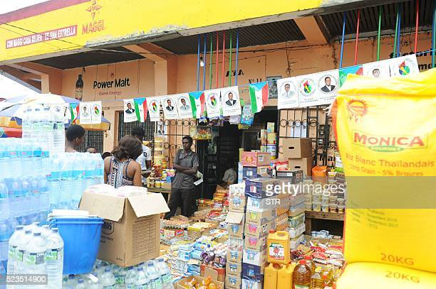 Equatorial Guinean flags and pictures of Equatorial Guinea incumbent president and candidate Teodoro Obiang Nguema hang in the central market in...
