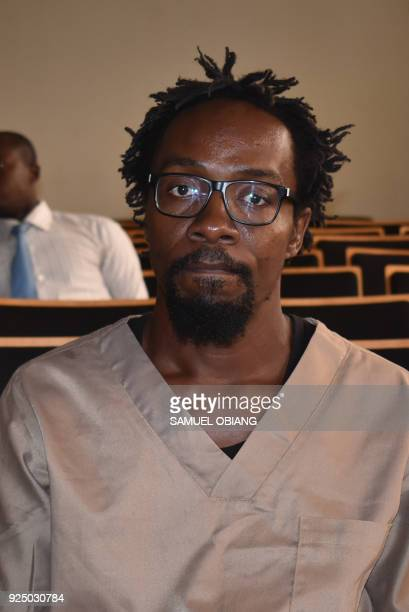 Equatorial Guinean illustrator and comics artist Ramon Nse Esono Ebale looks on in court in Malabo on February 27 2018 The prosecutor of Equatorial...