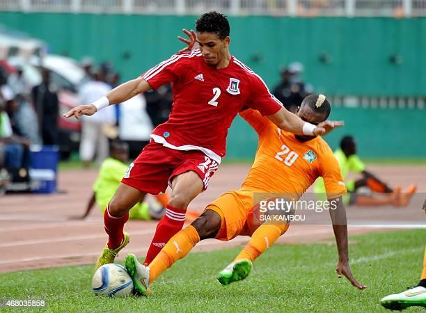Equatorial Guinea's Daniel Vaznez Evoy vies with Ivory Coast's Sery Die during the friendly football match Ivory Coast againt Equatorial Guinea on...