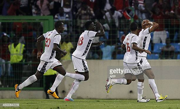 Equatorial Guinea's defender Jimmy Bermudez celebrates with teammates after scoring the equalizer during the FIFA 2014 World Cup friendly football...