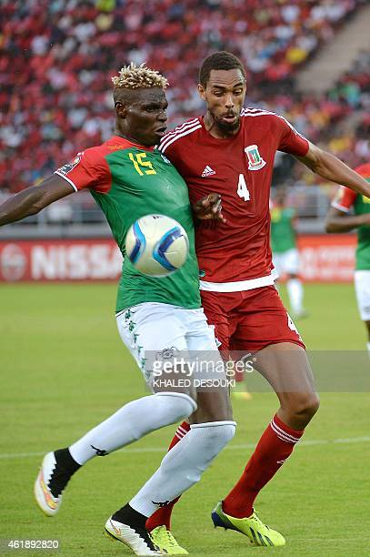 Equatorial Guinea's defender Rui challenges Burkina Faso's forward Aristide Bance during the 2015 African Cup of Nations group A football match...