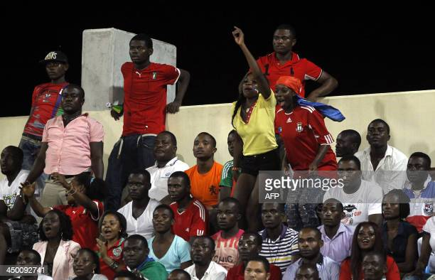 Equatorial Guinea's football fans react during the FIFA 2014 World Cup friendly football match Equatorial Guinea vs Spain at the Olympic stadium in...