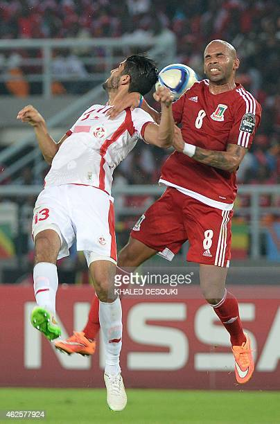 Equatorial Guinea's midfielder Randy heads the ball with Tunisia's midfielder Ferjani Sassi during the 2015 African Cup of Nations quarterfinal...
