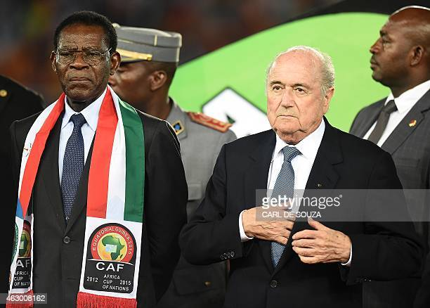 Equatorial Guinea's President Teodoro Obiang Nguema Mbasogo and FIFA president Sepp Blatter wait to hand the trophy to Ivory Coast's players at the...