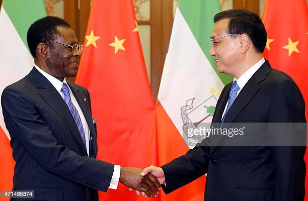 Equatorial Guinea's President Teodoro Obiang Nguema Mbasogo shakes hands with Chinese Premier Li Keqiang before a meeting at the Great Hall of the...