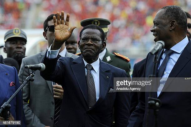 Equatorial Guinea's President Teodoro Obiang Nguema Mbasogo stands next to Congolese President Denis Sassou-Nguesso as he greets the crowd ahead of...