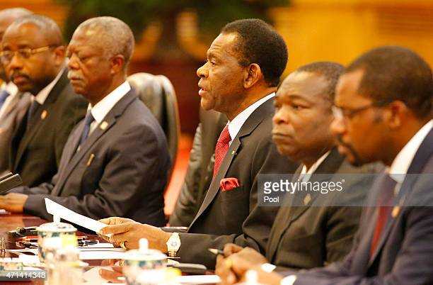 APRIl 28: Equatorial Guinea's President Teodoro Obiang Nguema Mbasogo talks with Chinese President Xi Jinping during a meeting at the Great Hall of...