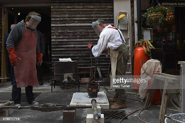 Equestrian artist Nic Fiddian Green helped by artist and foundry owner Chris Nash demonstrates his process of casting bronze sculptures outside the...