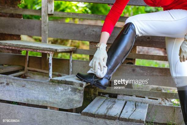 equestrian cleaning riding boots - leather boot stock pictures, royalty-free photos & images