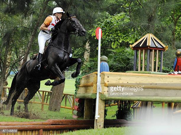 Equestrian Eventing Team rider of Germany Ingrid Klimke rides with Abraxxas during the cross country eventing competition at the 2008 Beijing Olympic...