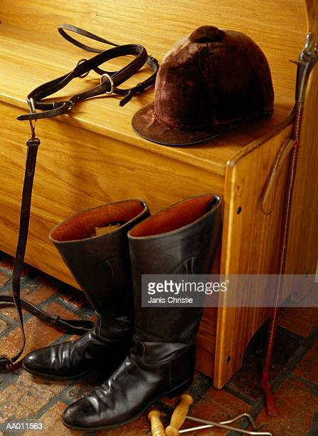 equestrian gear on a bench - riding crop stock photos and pictures