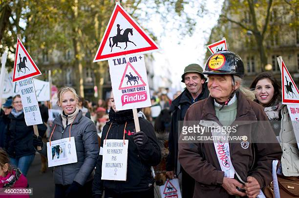 Equestrian professionals and horse riders demonstrate in Nantes western France on November 16 to protest against a ValueAdded Tax rise for equestrian...
